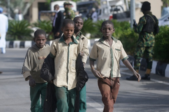 A group of schoolboys are escorted by Nigerian military and officials following their release after they were kidnapped last week [Sunday Alamba/AP]