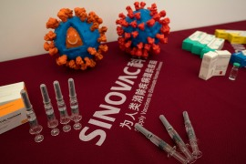 The companies whose products won prequalification include Sinovac and state-owned Sinopharm, both leading developers of COVID-19 vaccines [Ng Han Guan/AP]