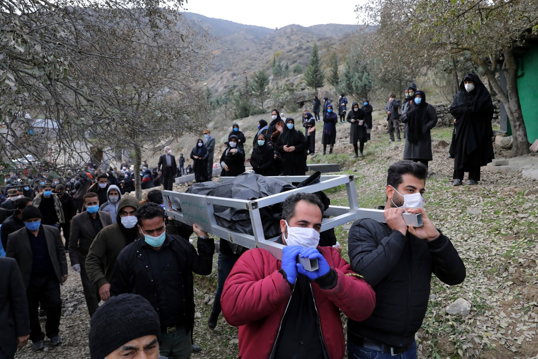 Mourners carry the body of Keyumars Ziaee, 60, in the Shir Kola village. [Ebrahim Noroozi/AP Photo]