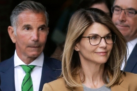 Lori Loughlin and husband Mossimo Giannulli depart federal court in Boston in April 2019 after facing charges in a nationwide college admissions bribery scandal [File: Steven Senne/AP Photo]