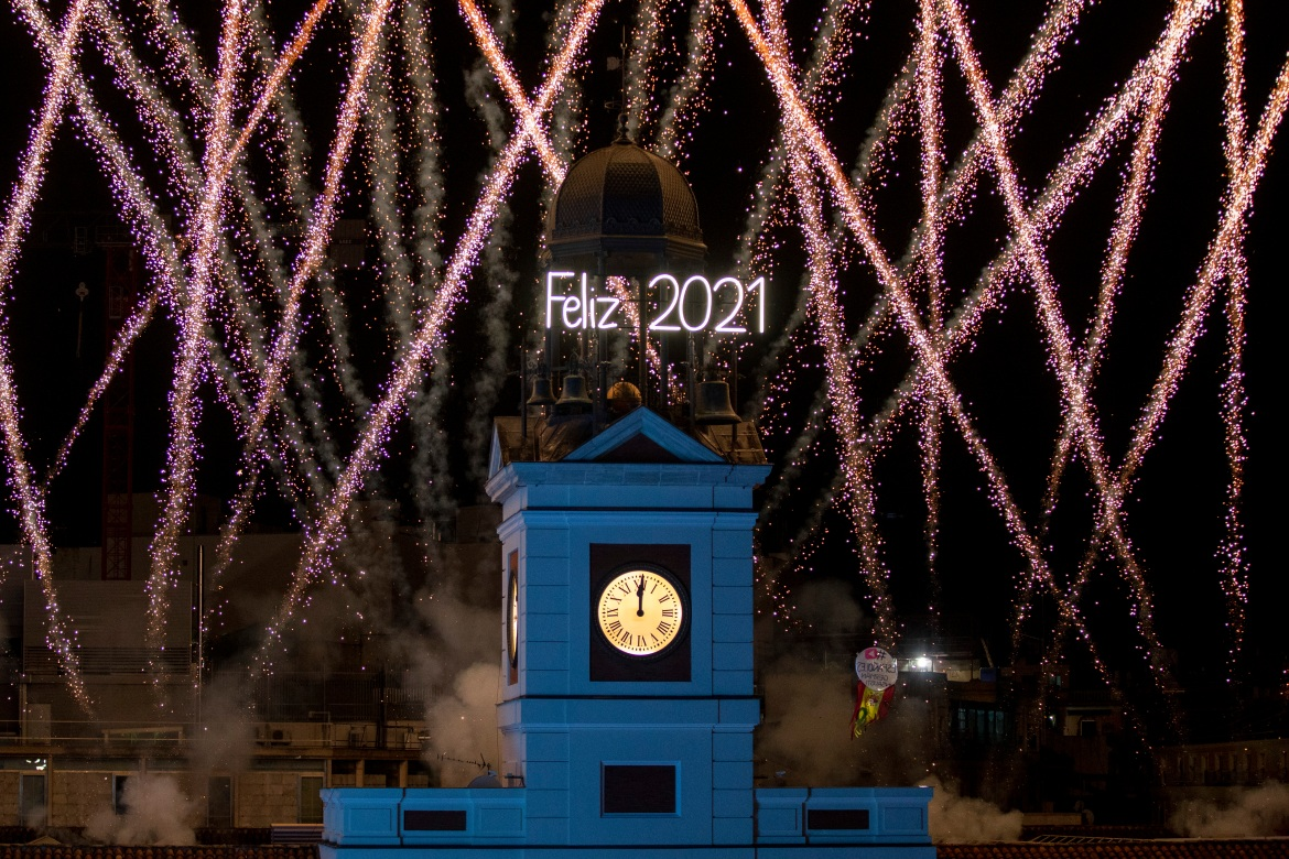A fireworks display is seen over Puerta del Sol Square on New Year's Eve in Madrid, Spain [Pablo Blazquez Dominguez/Getty Images]