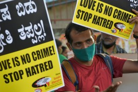 A civil right activist holds placards during a demonstration condemning the passing of laws against 'Love Jihad' by various state governments, Bangalore, India, December 1, 2020. [Manjunath Kiran/AFP]
