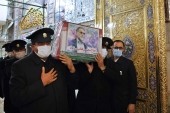 In this picture released by the Iranian defence ministry and taken on November 28, 2020, caretakers from the Imam Reza holy shrine, carry the flag-draped coffin of Mohsen Fakhrizadeh, an Iranian scientist who was assassinated, during his funeral in the northeastern city of Mashhad, Iran [Iranian defense ministry via AP]