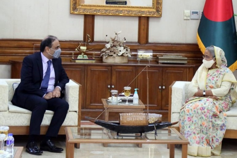 Pakistan's High Commissioner to Bangladesh with Bangladesh Prime Minister Sheikh Hasina in Dhaka [Photo courtesy: Pakistani Foreign Office] (Al Jazeera)