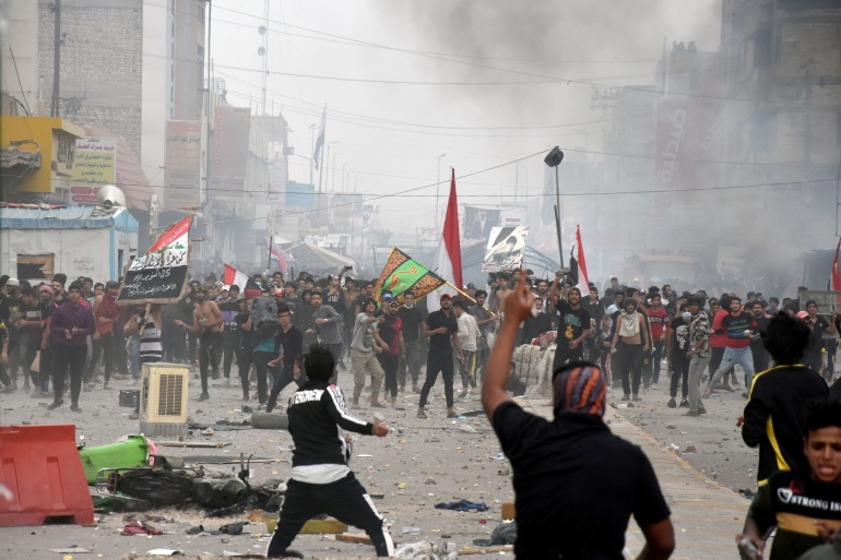 Last week, anti-government protesters fought with supporters of cleric Muqtada al-Sadr in Nasiriya [Ahmed Dhahi/Reuters]