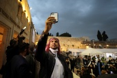 A member of the 'Sharaka' delegation from the United Arab Emirates and Bahrain takes a selfie during a visit to the Western Wall, Judaism's holiest prayer site, in Jerusalem's Old City on December 14, 2020 [Ammar Awad/Reuters]