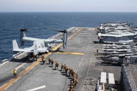 Marines load into a V-22 Osprey on the flight deck of the USS Makin Island (LHD8) as they conduct maritime operations off the coast of Somalia in support of Operation Octave Quartz (OOQ) on December 22, 2020 [Mass Communication Specialist 2nd Class Michael J Lieberknecht/US Navy via AFP]