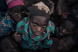 Displaced girls and boys from the Bafuliru community pose for a photograph in the internally displaced persons (IDP) camp of Bijombo, South Kivu Province, eastern Democratic Republic of Congo, on October 9, 2020. (AFP/Alexis Huguet) (AFP)