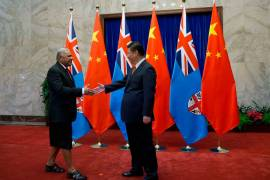 Chinese President Xi Jinping welcomes Fiji's Prime Minister Frank Bainimarama during a visit to Beijing [File: Andy Wong/EPA]