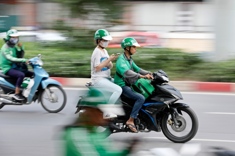 Grab says it is in a 'position to acquire' amid rumours of a merger with rival Gojek [File: Minh Hoang/EPA]