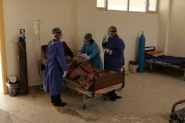 Hospital staff attend to a patient in the city of Manbij, northern Syria [Andrea Prada Bianchi/Al Jazeera]