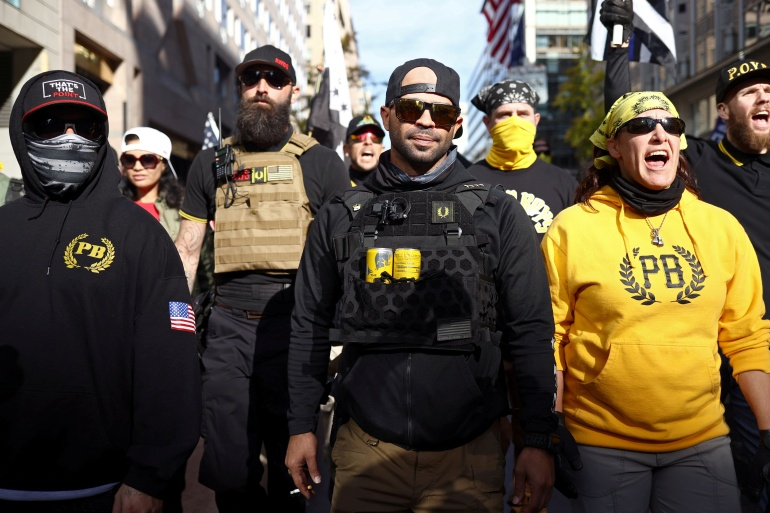 Members of the far-right Proud Boys rally in support of US President Donald Trump to protest against the results of the 2020 US presidential election, in Washington, DC, on November 14, 2020 [Hannah McKay/Reuters]
