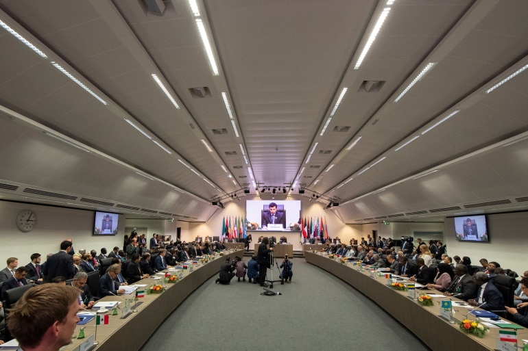 After their last summit, OPEC+ members agreed to increase production by half a million barrels a day in January [File: Joe Klamar/AFP]