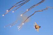 An Israeli F-15 I fighter jet launches anti-missile flares during an air show [File: Jack Guez/AFP]