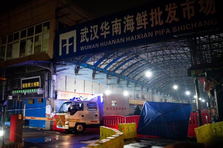 The WHO team is expected to visit the Huanan market, which was swiftly disinfected and closed a year ago after the first cases of what COVID emerged there [File: Noel Celis/AFP]