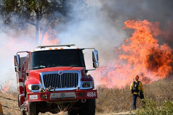 Climate change has been blamed for severe weather conditions such as the deadly wildfires in the US in 2020 [File: Robyn Beck/AFP]