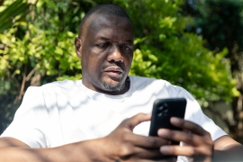 Chin'ono, 48, who has a large social media following, has been critical of President Emmerson Mnangagwa's government, accusing his government of corruption and mismanagement [File: Jekesai Njikizana/AFP]