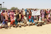Sudanese internally displaced people stage a sit-in to protest against the end of the mandate of the United Nations and African Union peacekeeping mission (UNAMID), in Kalma camp in Nyala, the capital of South Darfur [AFP]