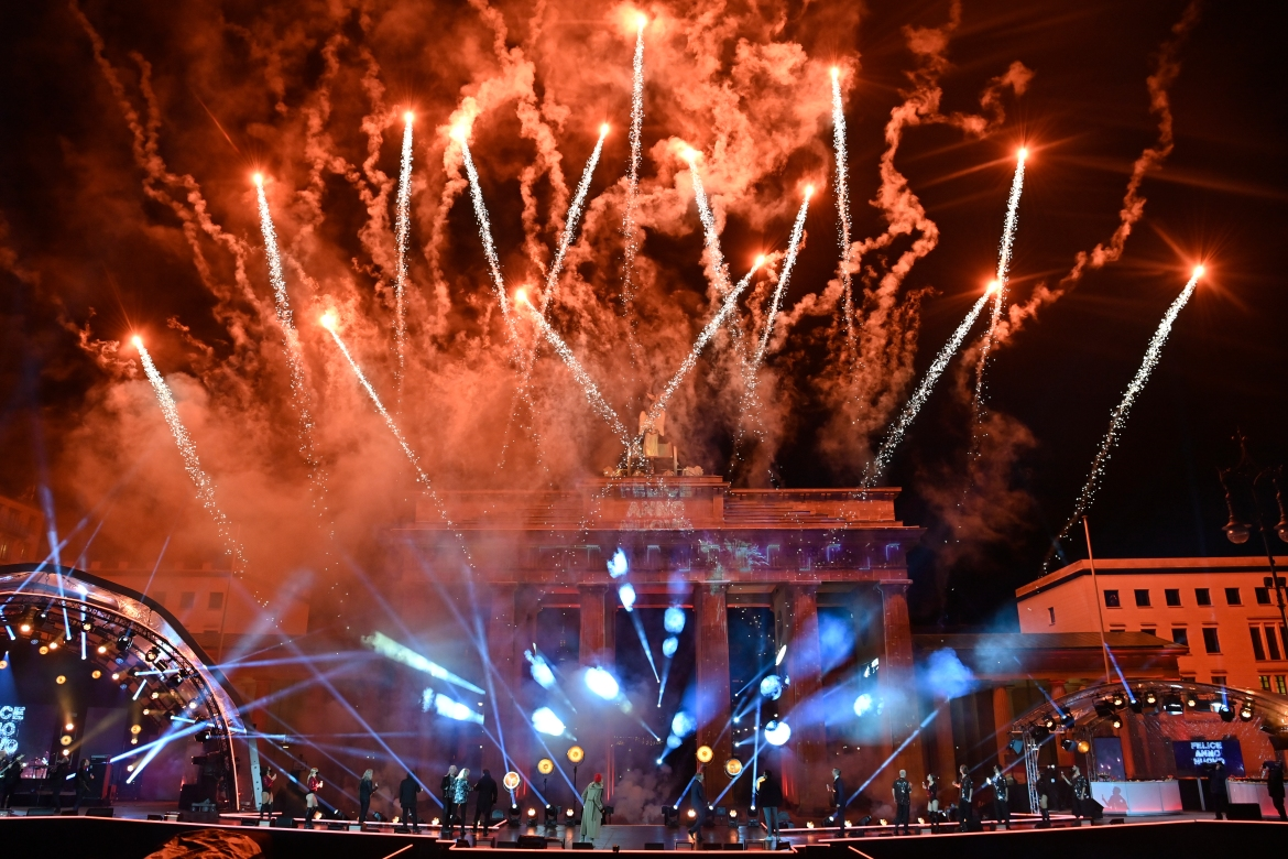 Germans were urged to stay at home, but there was a spectacular firework display over the Brandenburg Gate [John MacDougall/AFP]