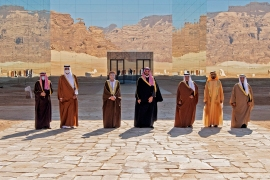 A handout picture provided by the Saudi Royal Palace on January 5, 2021, shows from L to R: Kuwaiti Emir Sheikh Nawaf al-Ahmad Al-Sabah, Emir of Qatar Tamim bin Hamad Al-Thani, Omani Deputy Prime Minister Fahd Bin Mahmud, Saudi Crown Prince Mohammed bin Salman, Bahrain's Crown Prince Salman bin Hamad Al-Khalifa, Dubai's Ruler and UAE Vice President Sheikh Mohammed bin Rashid Al-Maktoum and Nayef al-Hajraf, secretary-general of the Gulf Cooperation Council (GCC) posing for a pictures before the opening session of the 41st Gulf Cooperation Council (GCC) summit in the northwestern Saudi city of al-Ula. [Photo by BANDAR AL-JALOUD / Saudi Royal Palace / AFP]