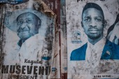 Posters of two most popular candidates for Uganda's Presidential election, incumbent President Yoweri Museveni (L) and Robert Kyagulanyi, aka Bobi Wine, the pop star-turned-opposition leader, are seen along a street in Kampala, Uganda, on January 6, 2021. - Uganda gears up for presidential elections which is scheduled to take place on January 14, 2021, as President Yoweri Museveni seeks another term to continue his 35-year rule.poster of Uganda's President Yoweri Museveni who is running for his 6th presidential term. (Photo by SUMY SADURNI / AFP) (AFP)