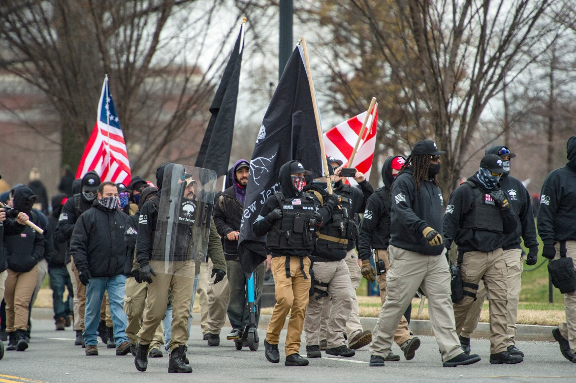 A militia-like group makes their way to a rally for US President Donald Trump. [Joseph Prezioso/AFP]