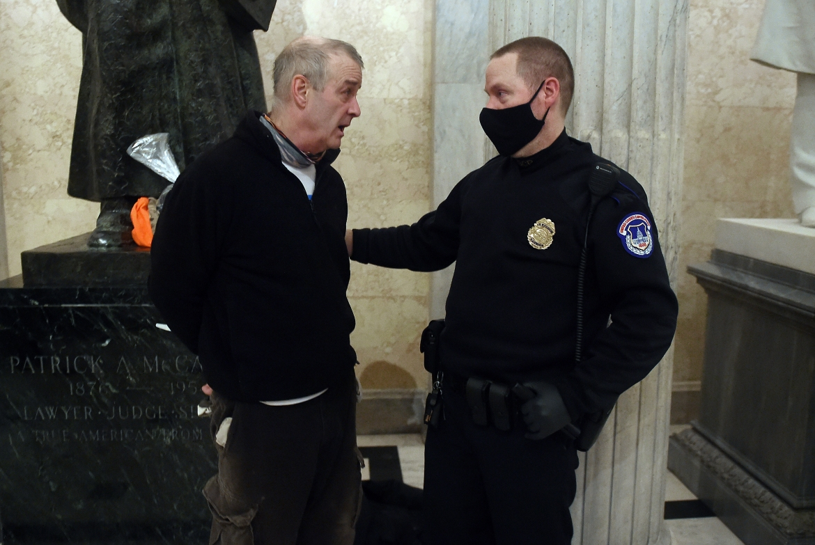 A supporter of President Trump is arrested inside the US Capitol. [Olivier Douliery/AFP]
