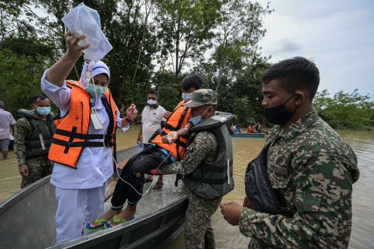 Adding to the complexity of rescue efforts, Malaysia is seeing a surge in coronavirus cases, reporting its biggest daily rise on Thursday [Mohd Rasfan/AFP]