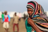 An Ethiopian refugee from Tigray walks in the Tenedba camp in Mafaza, eastern Sudan [Ashraf Shazly/AFP]