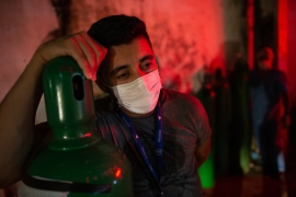 A man holds an oxygen tank in Manaus on January 15, as medical workers are battling a shortage of oxygen and other essential equipment to respond to a surge in COVID-19 cases [File: Michael Dantas/AFP]