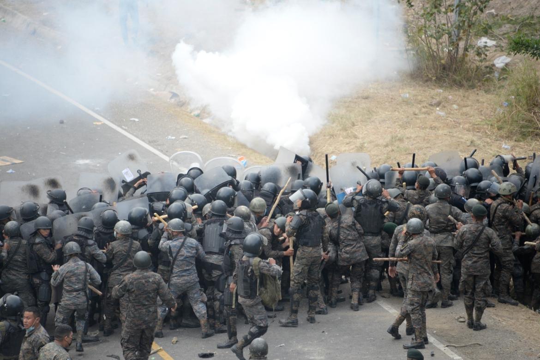 Guatemalan police fire tear gas to disperse a caravan of thousands of migrants heading towards the US. [Johan Ordonez/AFP]