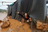 Children play in the Umm Jurn camp for the displaced, near the village of Kafr Uruq, in Syria's northern rebel-held Idlib province [Abdulaziz Ketaz/AFP]