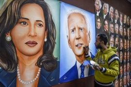 Painter Jagjot Singh Rubal gives the final touches to a painting depicting US President-elect Joe Biden, right, and Vice President-elect Kamala Harris, left, in Amritsar, Punjab state. [Narinder Nanu/AFP]