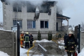 Firefighters work at the site of a fire in a nursing home in Kharkiv [State Emergency Service of Ukraine/AFP]