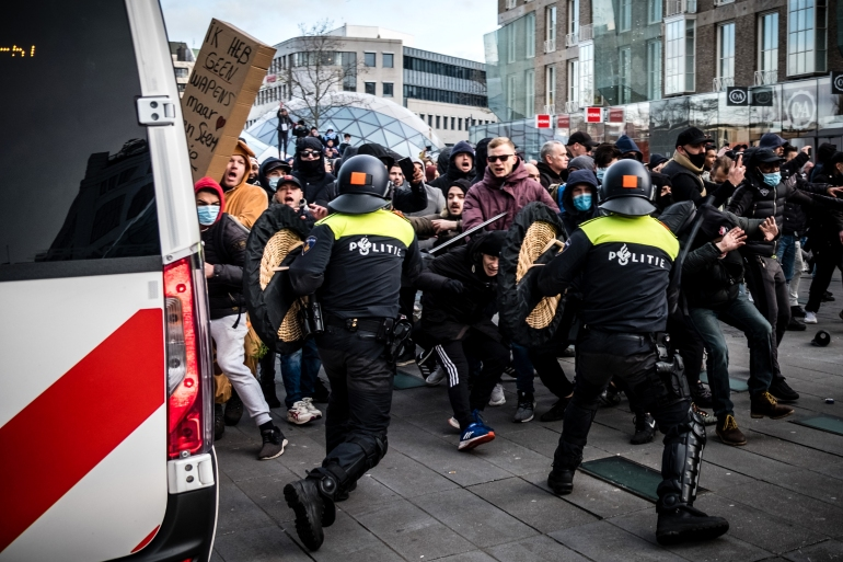 Dutch police clash with anti-lockdown rioters in two cities | Coronavirus pandemic News
