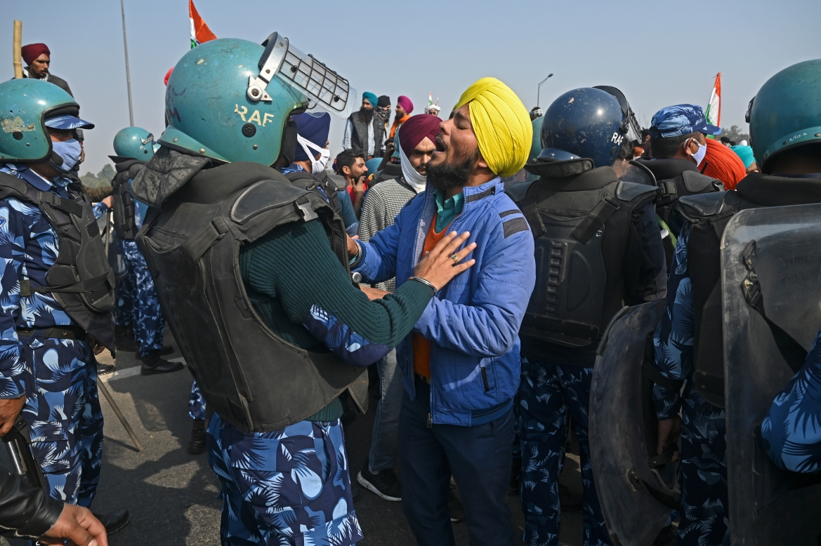 Farmers scuffle with security personnel during the rally. Police launched one of their largest security operations in years to stop the demonstrators. [Sajjad Hussain/AFP]