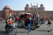 Farmers take part in a tractor rally as they protest against the government's new farm laws, in front of the Red Fort in New Delhi. [Sajjad Hussain/AFP]