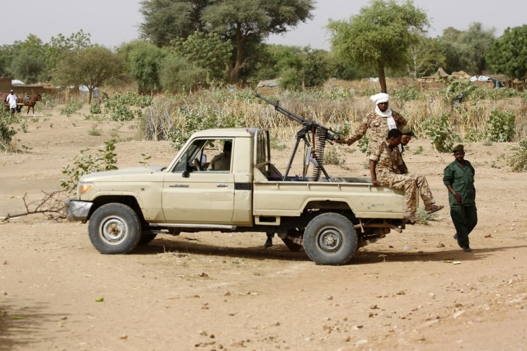 Sudanese security forces patrol in al-Geneina, West Darfur [File: Ashraf Shazly/AFP]