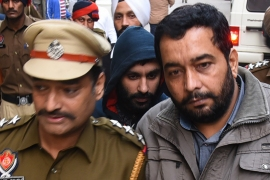 Indian authorities accuse Johal, pictured centre, of being involved in a series of killings of Hindu leaders in Punjab, a Sikh-majority region [File: Shammi Mehra/AFP]
