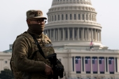 A National Guard stands at the US Capitol before the inauguration in Washington, DC [Liz Lynch/Getty Images/AFP]