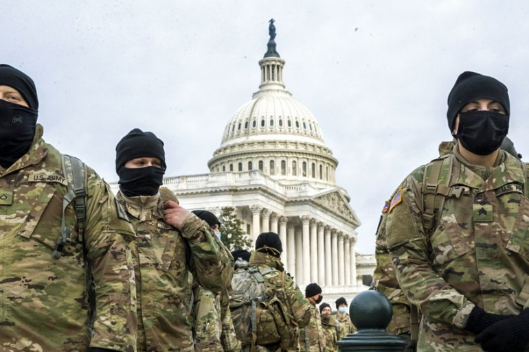 Members of the New York National Guard form up on the East Front of the US Capitol in Washington, DC, on January 11 [Shawn Thew/EPA]