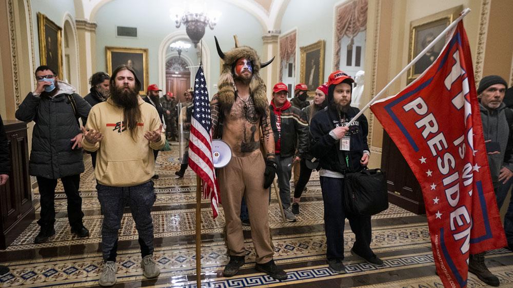 Biden orders threat assessment of violent domestic groups thumbnail