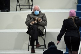 Former presidential candidate, Senator Bernie Sanders, sits in the bleachers on Capitol Hill before Joe Biden is sworn in as the 46th US President at the US Capitol on January 20, in Washington [File: Brendan Smialowski/AFP]