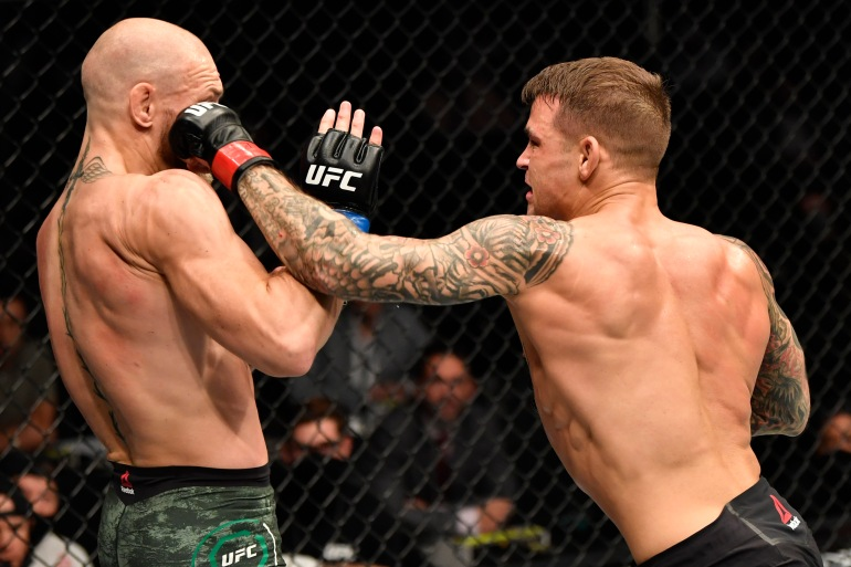 Poirier, right, used low calf kicks in an effort to put McGregor off his usual ferocious stand-up game - and it worked [Getty]