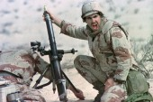 File photo of Lance Corporal John Clark, of the 6th Marines, shouting to colleagues while preparing to fire a mortar shell on January 11, 1991. The Marines were conducting a live fire session while preparing for the Gulf War. AC/CLH/ (Reuters)