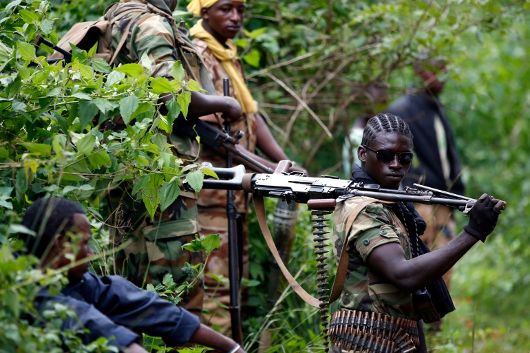 A Seleka fighter holds his machine gun near the town of Kuango, close to the border with Democratic Republic of the Congo June 9, 2014 [File: Goran Tomasevic/ Reuters]