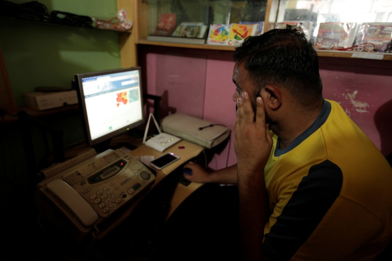 A man explores social media on a computer at an internet cafe in Islamabad [Faisal Mahmood/Reuters]