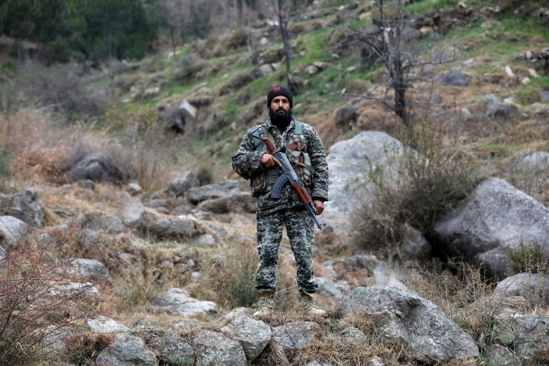 A Pakistan Army soldier guards the area struck by Indian military planes on February 26, 2019 in Jaba village near Balakot, Pakistan [File: Akhtar Soomro/Reuters]
