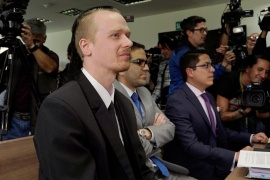 Swedish software developer Ola Bini sits in court after a local judge ordered him jailed for alleged involvement in hacking government computer systems, in Quito, Ecuador, on May 2, 2019 [Daniel Tapia/Reuters]