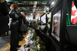 Flowers and photos of the victims set up at a memorial service at the University of Alberta for the victims of a Ukrainian passenger plane that crashed in Iran, in Edmonton, Alberta, Canada on January 12, 2020 [File: Candace Elliott/Reuters]